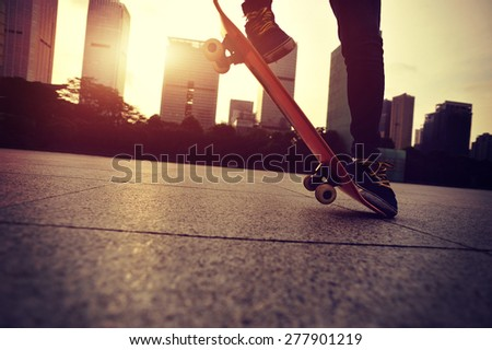 skateboarder doing skateboarding trick ollie on sunrise city - stock photo