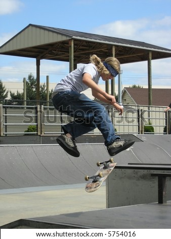 Skateboarder Doing Trick - stock photo