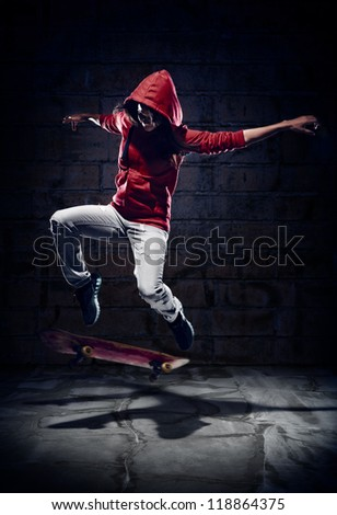 Skateboarder doing trick with grunge background red hoodie and skill