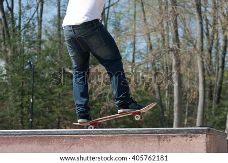 Skateboarder Freestyle at the Park - stock photo