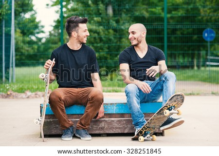 Skateboarder friends portrait having fun at skatepark. - stock photo