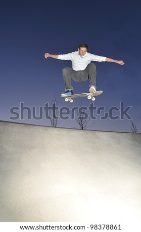 Skateboarder in action at the skate park.