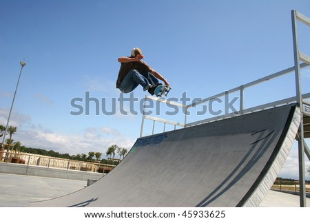 skateboarder in action on a ramp - stock photo