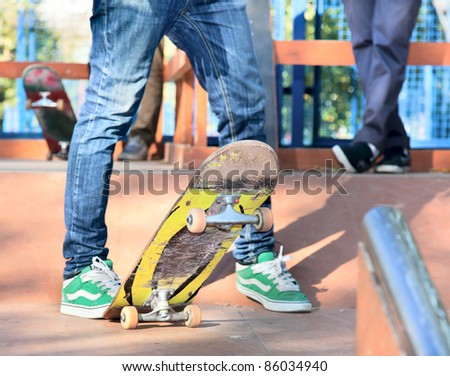 Skateboarder legs before jumping on the railing - stock photo