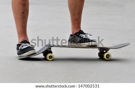 skateboarder on a broken skateboard - stock photo