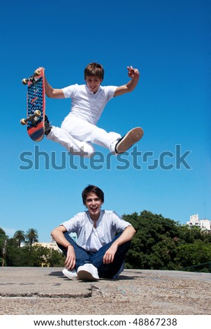 Skateboarder on a high and dangerous jump - stock photo