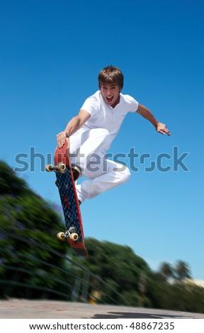 Skateboarder on a high jump - stock photo