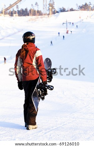 Skateboarder on the snowhill - stock photo