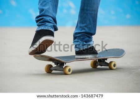 Skateboarder riding skateboard at skate park. - stock photo
