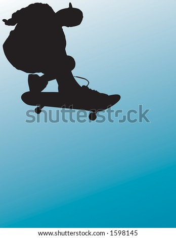 Skateboarder silhouette pulling a grab and getting some air. - stock photo