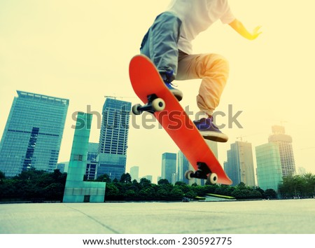 skateboarder skateboarding at city  - stock photo