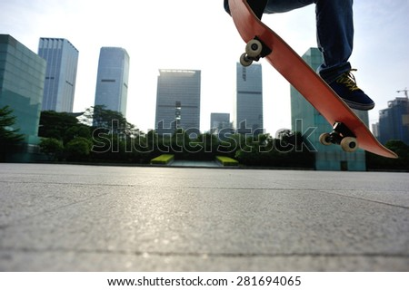 skateboarder skateboarding at city - stock photo