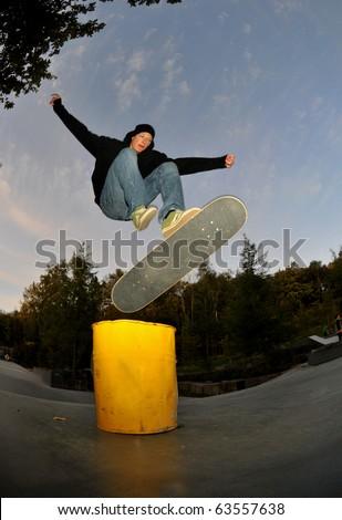 skateboarding before darkness at the local skate park,slight motion blur. - stock photo