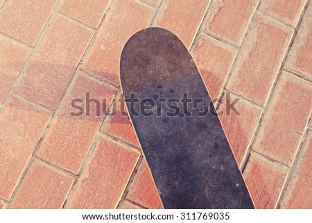 Skateboarding concept. Skate board from above view. A lot of space for text. Toned image filter - stock photo