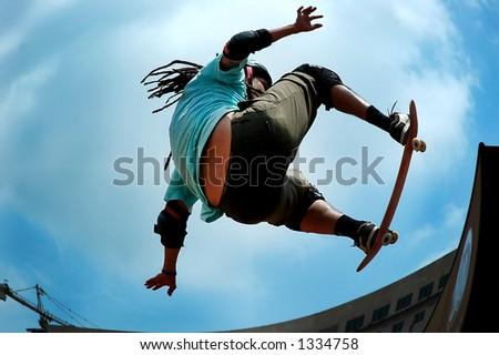 Skateboarding - on the air - stock photo