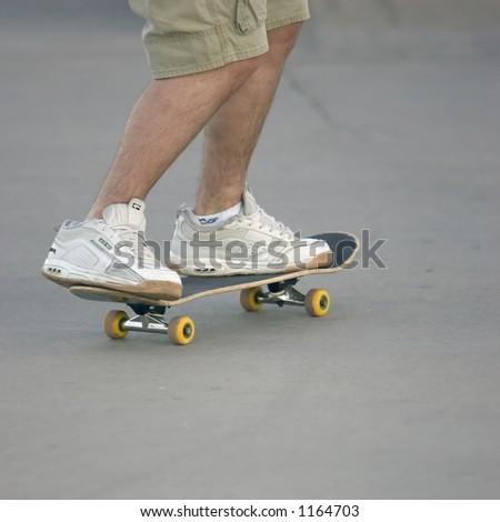 Skateboarding teen, knees down - stock photo