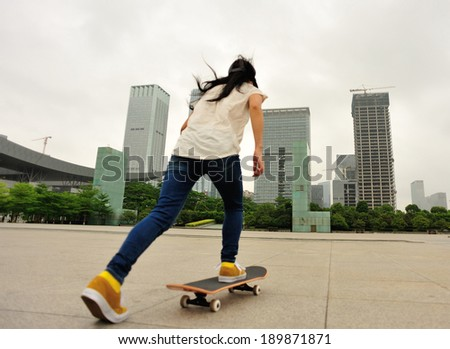 skateboarding woman in the city