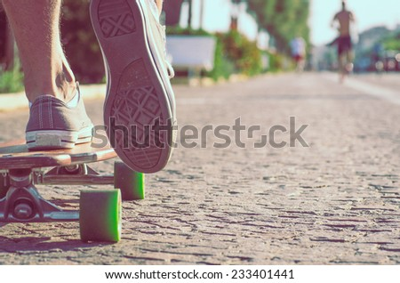 skater boy in action on a walkway. concept about recreation and hipster style - stock photo
