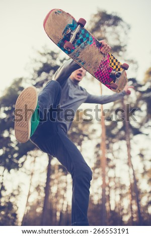 skater guy jumps - stock photo
