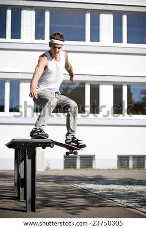 skater making a slide with his skateboard