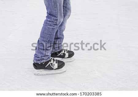 Skater on ice skating rink, sport and fun - stock photo