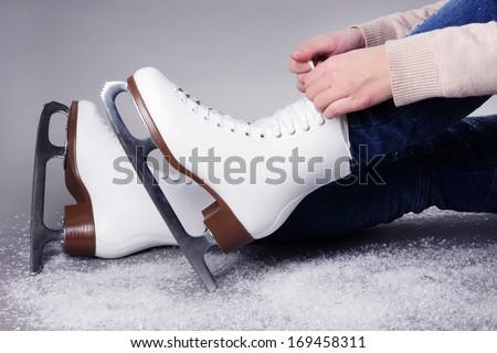Skater wearing skates on gray background - stock photo