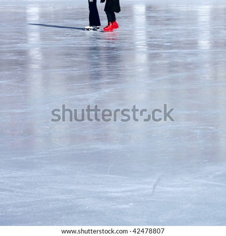 Skaters on ice - stock photo