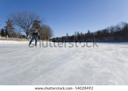 Skaters on ice of Rideau Canal, Ottawa. - stock photo