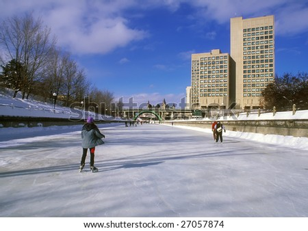 Skaters on the Rideau Canal in Ottawa, Canada.  A UNESCO heritage site.