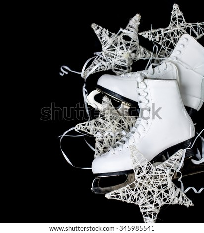Skates and Christmas Decoration - stock photo