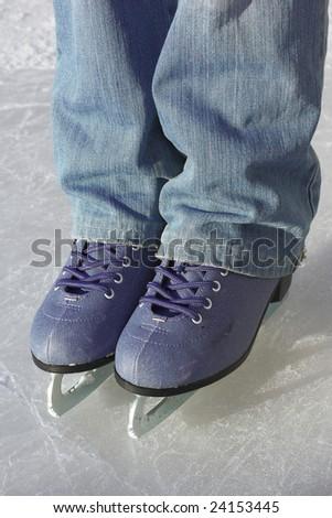 Skates on ice - stock photo