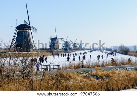 Skating people in a typical dutch scenery - stock photo