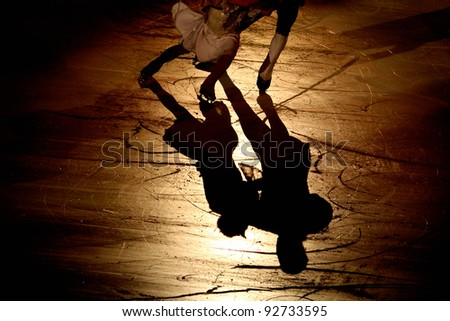 skating silhouette of people dancing  on the ice - stock photo