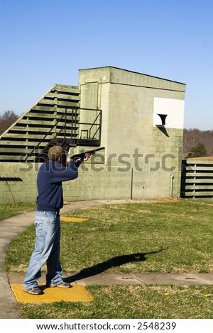 Skeet shooter photographed at a northern Virginia gun club. - stock photo