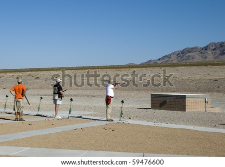Skeet shooting at a desert range - stock photo