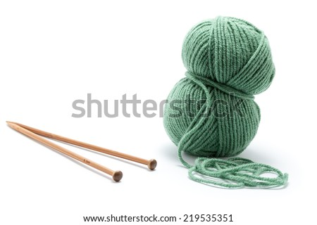 Skein of green yarn with knitting needles - stock photo