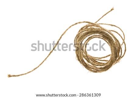 Skein of jute twine on the white background - stock photo