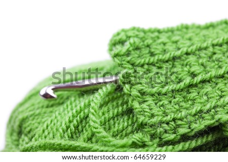 Skein of wool, crochet hook  and knitted piece isolated on white - stock photo