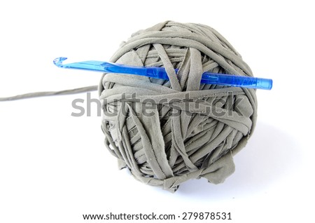 Skein trapillo zpagetti t-shirt yarn with a crochet hook. Isolated on white background