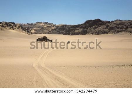 SKELETON COAST DESERT, NAMIBIA, JANUARY 11: 4x4 off-road car driving in the Skeleton Coast Desert with blue sky. Namibia 2010 - stock photo