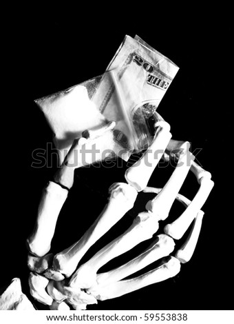 skeleton hand holds drug baggie and money - stock photo