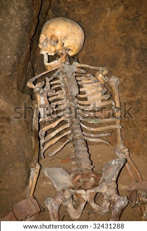 Skeleton in dungeons - stock photo
