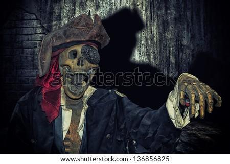Skeleton in pirate suit indoor - stock photo