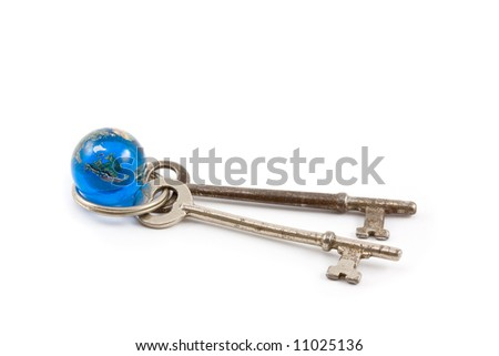 Skeleton Keys with Globe Marble on White - stock photo
