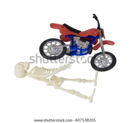 Skeleton laying on ground next to Motorcycle - path included - stock photo