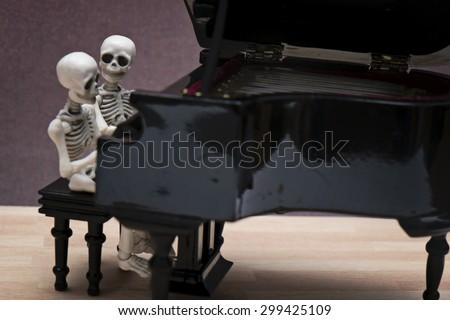 skeleton piano session - stock photo
