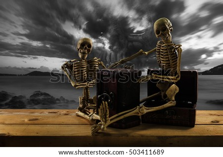 Skeleton pirate sitting on a treasure chest and old wood floor, sky background ,concept Halloween background