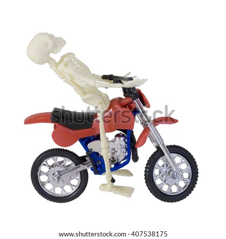 Skeleton Riding Red and Blue Motorcycle - path included - stock photo