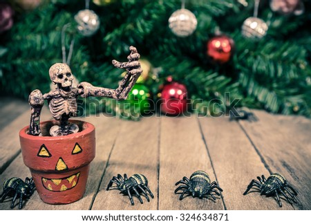 Skeleton Sitting in Orange Pots with Tiny Spiders for Background Texture - stock photo