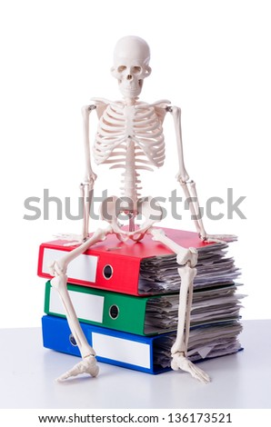 Skeleton with pile of files on white